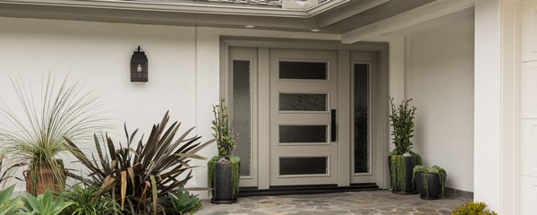 decorative image of luxury home with a custom painted door with glass sidelights